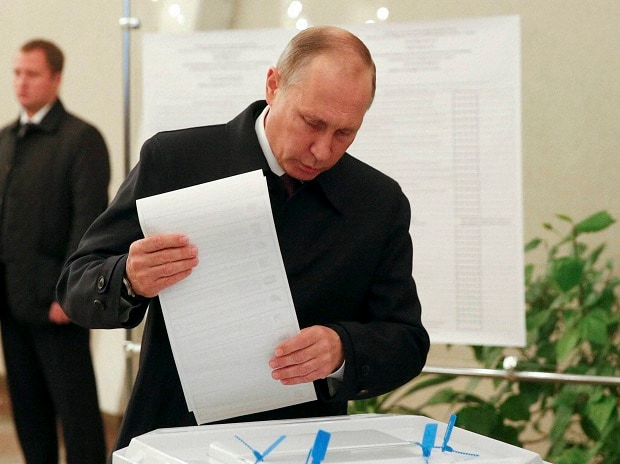 resident Vladimir Putin casts his ballot at a polling station during a parliamentary election in Moscow, Russia.