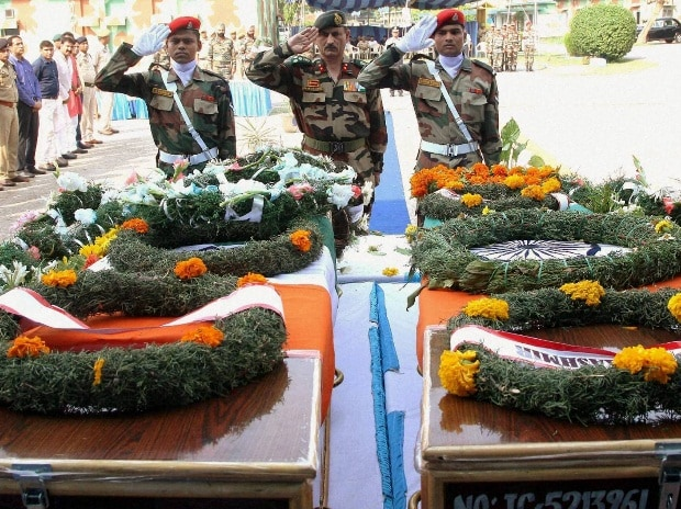 An army officer paying tribute to the soldiers who were killed in Uri attack at a wreath laying ceremony in Jammu.