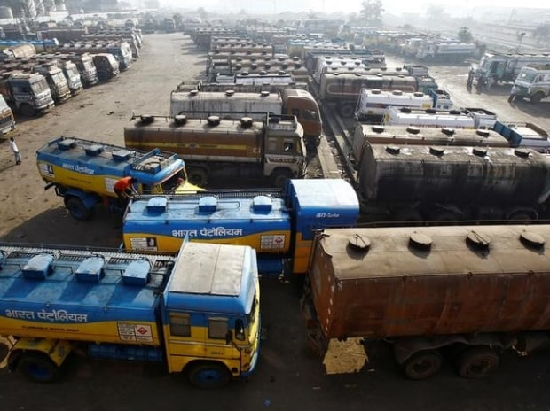 Oil tankers are seen parked at a yard outside a fuel depot