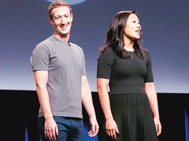 Priscilla Chan (right) and husband Mark Zuckerberg