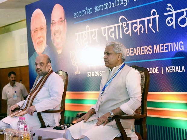 BJP National President Amit Shah (L) and party leader Ram Lal at the inauguration of the party's National Council Meeting in Kozhikode, Kerala