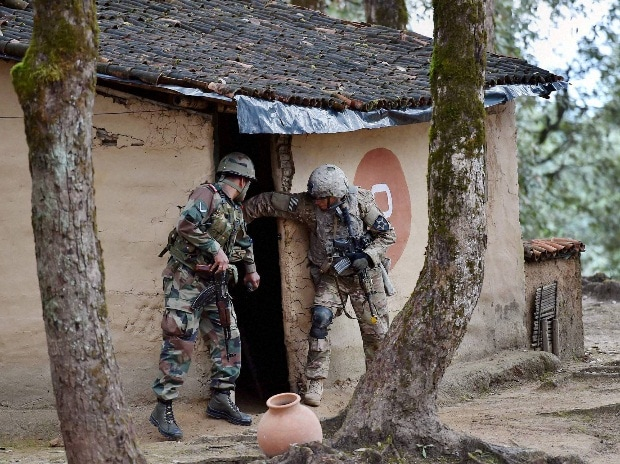 Indian and US soldiers in action at a mock CI village during the Indo-US joint exercise Yudh Abhyas 2016 at Chaubattia, Ranikhet in Uttrakhand.