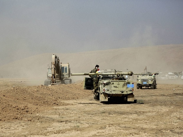A peshmerga convoy drives towards a frontline in Khazer, about 30 kilometers (19 miles) east of Mosul, Iraq,