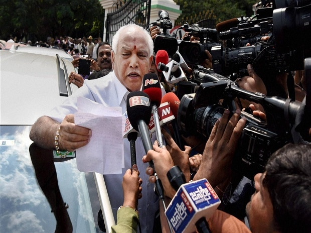 BJP state president B S Yeddyurappa speaks to media after CBI court cleared all charges against him, in Bengaluru