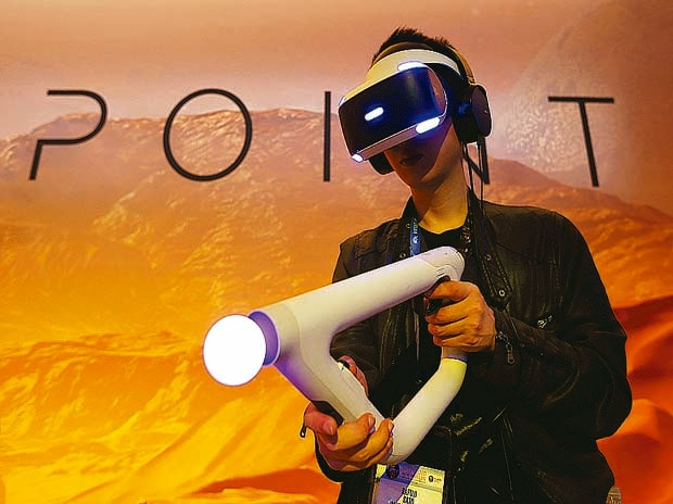 A man plays Sony Playstation's Farpoint Impulse Gear Virtual Reality game at the E3 Electronic Expo in Los Angeles