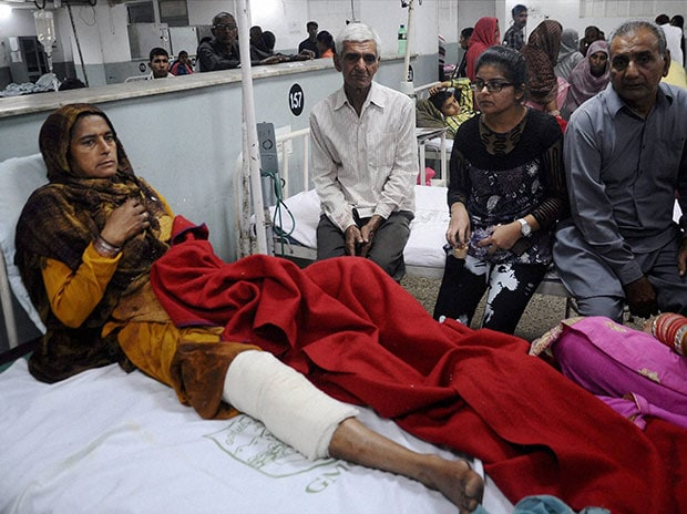 A villager is treated at the Government Medical Hospital after being injured by the firing from across the India-Pakistan International Border of RS Pura sector in Jammu. (Photo: PTI)
