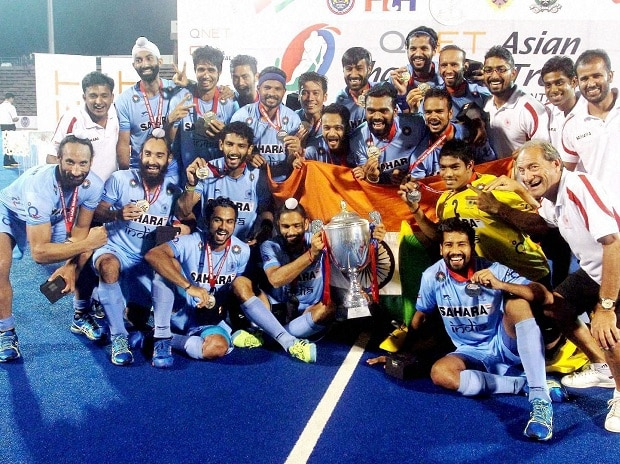 Indian hockey players pose with the Asian Champions Trophy after they beat Pakistan in the final in Kuantan, Malaysia