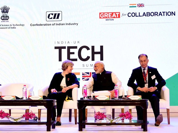 UK Prime Minister Theresa May with her Indian counterpart Narendra Modi at UK-India Tech Summit in New Delhi. (Photo: Twitter/@narendramodi)