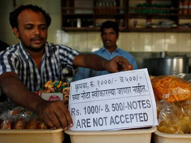 A man puts a notice inside his eatery stall in Mumbai (Reuters)