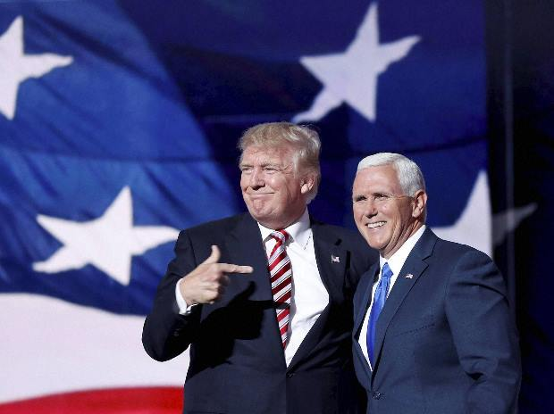 Donald Trump, points toward Republican Vice presidential candidate Gov. Mike Pence