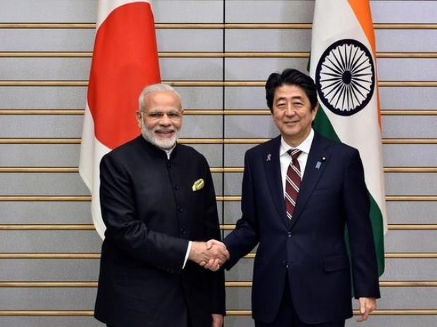 Indian PM Narendra Modi (left) shaking hands with Japan's PM Shinzo Abe in Tokyo. (Photo: Reuters)