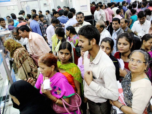 People queue up inside a bank to exchange their old Rs 1000 and 500 notes in Allahabad. (Photo: PTI)