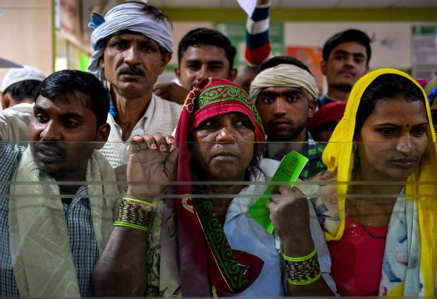 Indian villagers wait inside a bank to make the transactions in Basendua village in the northern state of Uttar Pradesh on Wednesday. Photo: Agence France-Presse/Getty Images