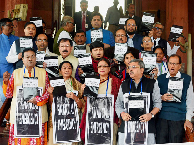 TMC members protest at Parliament during the winter session, in New Delhi. (Photo: PTI)
