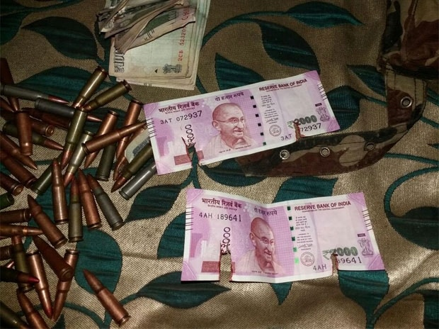 New Rs 2000 notes recovered from terrorists gunned down by Army in Bandipora. (Photo: Twitter/@ANI_news)