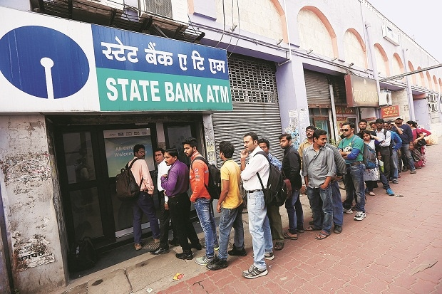 Line of discontent: People queue outside an ATM of State Bank of India to withdraw money in Kolkata