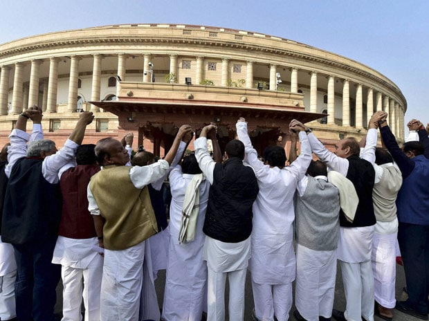 MP's of Opposition parties during a protest outside Parliament against the government's move to demonetise high tender notes, in New Delhi. Photo:PTI