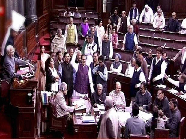 Opposition members protest in the Rajya Sabha in New Delhi. Photo: PTI