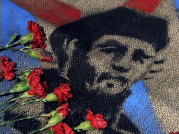 Roses placed by members of Mexico's communist party lay atop an image of late Cuban President Fidel Castro, outside the Cuban Embassy in Mexico City.