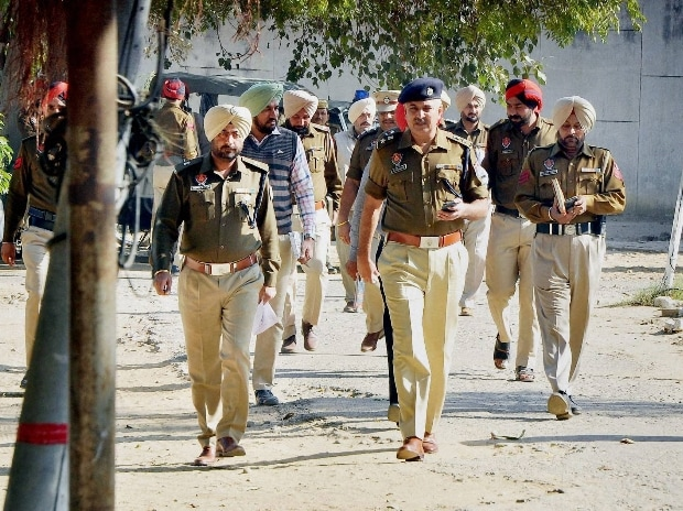 Police officials investigate after six inmates of Nabha Jail including dreaded Khalistan ultra and Khalistan Liberation Force (KLF) chief Harminder Mintoo escaped near Patiala (Photo: PTI)