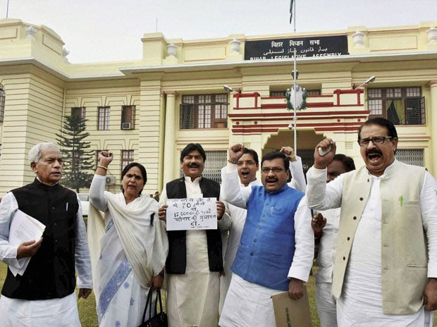 RJD legislators protest against demonetisation during the ongoing Winter-session of the Bihar Assembly in Patna. Photo: PTI