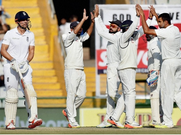 Indian players celebrate the wicket of Alastair Cook, who was dismissed by R Ashwin, on the third day of the third Test match between India and England, in Mohali on Monday (Photo: PTI)