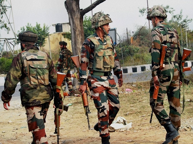 Army personnel take position during encounter after militants attacked an Army camp in Nagrota on the outskirts of Jammu