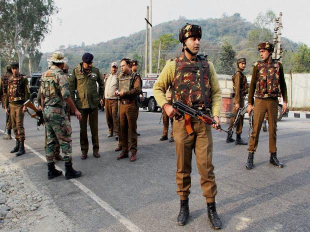 Security personnel take positions during a gun battle with suspected militants at the Army camp in Nagrota in Jammu