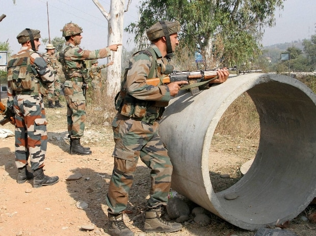 Security personnel take positions during a gun battle with suspected militants at Army camp at Nagrota near Jammu