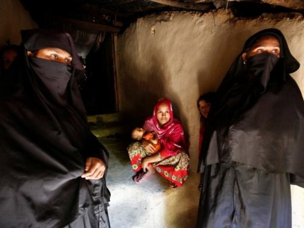 Rohingya Muslim women look outside as many new refugees arrive near the Kutupalang Refugee Camp in Cox's Bazar, Bangladesh. <b>Photo: Reuters</b>