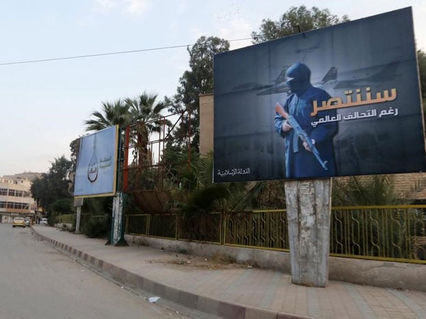 Islamic State billboards are seen along a street