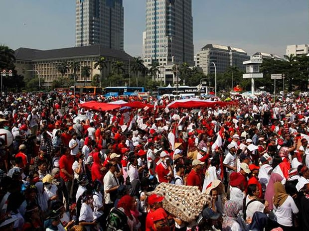 People take part in a rally against what they see as growing racial and religious intolerance in the world's largest Muslim-majority country in Jakarta