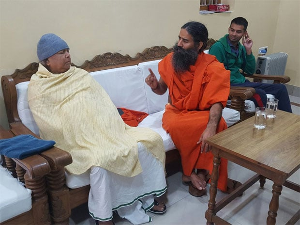 RJD Chief Lalu Prasad with yoga guru Ramdev. Photo: Twitter (@laluprasadrjd)