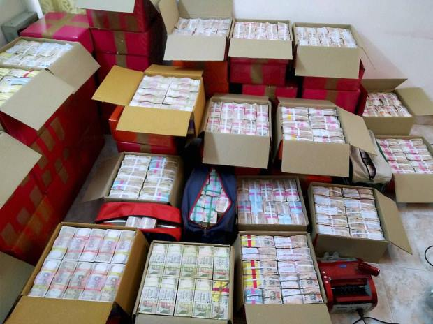 Cash seized by the Income Tax department after it conducted searches