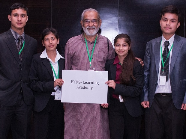 PYDS' founder and secretary G K Swamy (centre)