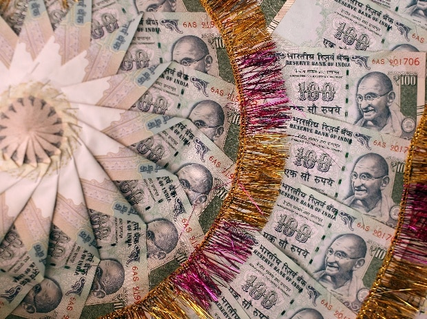A garland made of hundred rupee notes