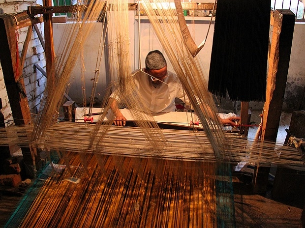 Weavers reel under post-GST hike in yarn prices