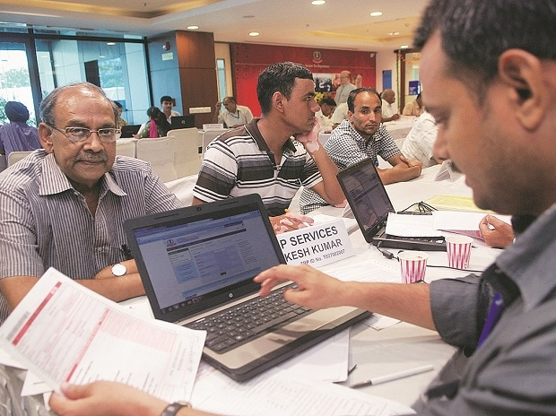 A file photo of people filing their income tax returns in New Delhi