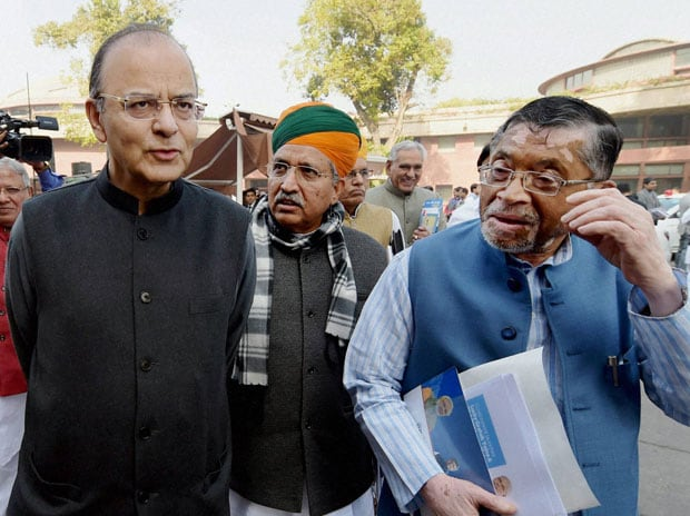 Finance Minister Arun Jaitley with MoS Finance Arjun Ram Meghwal and Santosh Gangwar at Parliament House in New Delhi. Photo: PTI