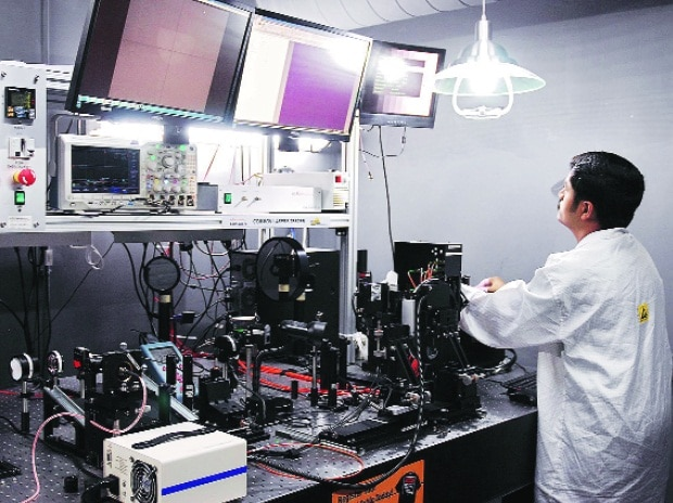 An employee at Alpha Design's satellite manufacturing facility in Bengaluru