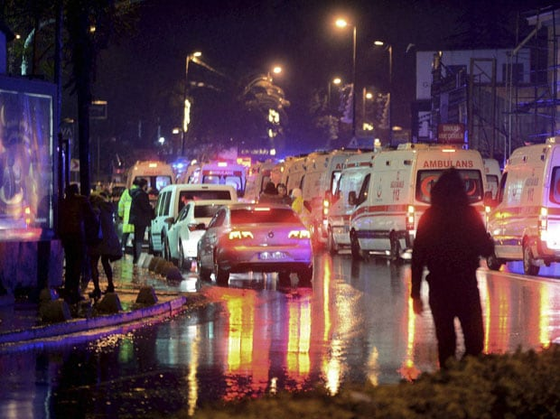 Medics and security officials work at the scene after an attack at a popular nightclub in Istanbul