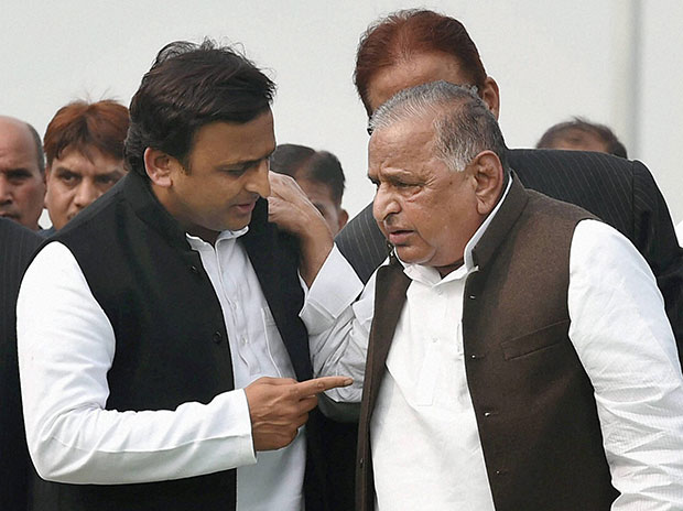 Uttar Pradesh Chief Minister Akhilesh Yadav with SP supremo Mulayam Singh Yadav. Photo: PTI