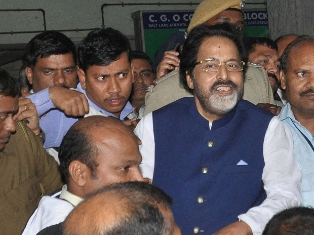 TMC MP Sudip Bandopadhyay being taken by CBI officers to Bhubaneswar