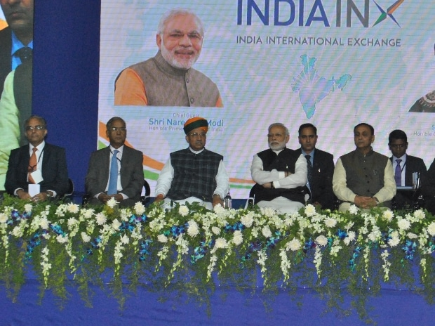 Prime Minister Narendra Modi with Gujarat CM Vijay Rupani and MoS Arjunram Meghwal at the inaugural function of BSE INDIAINX (India International Exchange) in Gandhinagar