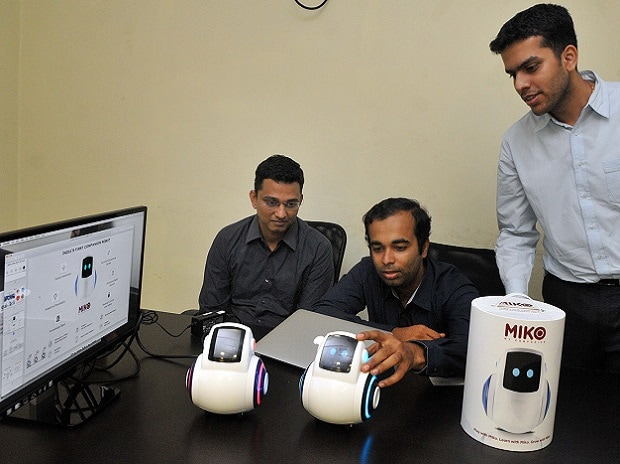(Left to right) Prashant Iyengar, Sneh Vaswani and Chintan Raikar with the robot called Miko
