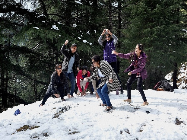 Tourists throwing snowballs at each other in Shimla