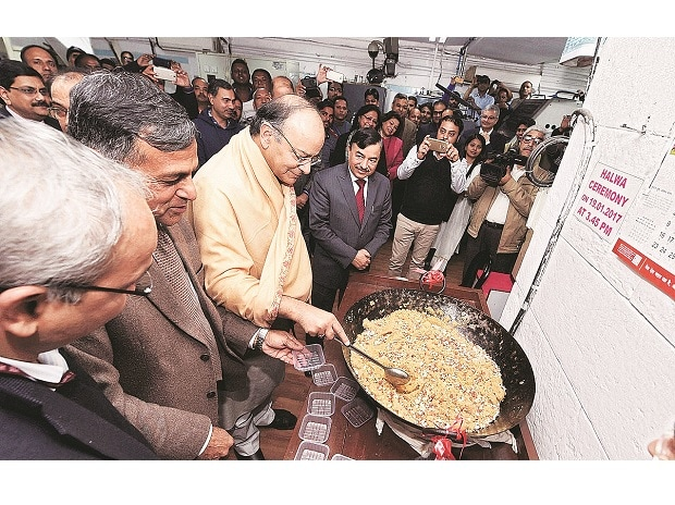 Union Finance Minister Arun Jaitley with FinMin officials at the halwa ceremony, marking the beginning of printing of budgetary documents, in New Delhi on Thursday