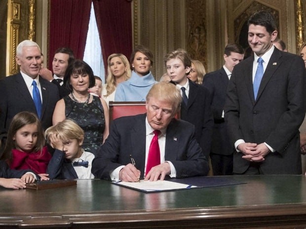 President Donald Trump is joined by the Congressional leadership and his family as he formally signs his cabinet nominations into law