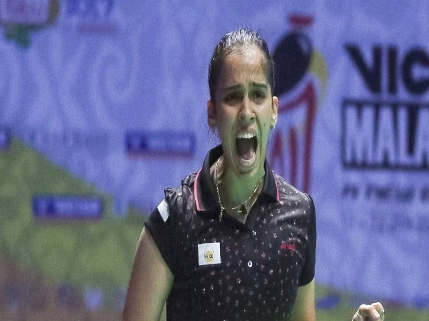 Saina Nehwal celebrates after defeating Thailand 's Pornpawee Chochuwong during Malaysia Masters badminton tournament women's singles final in Malaysia. (Photo: AP)