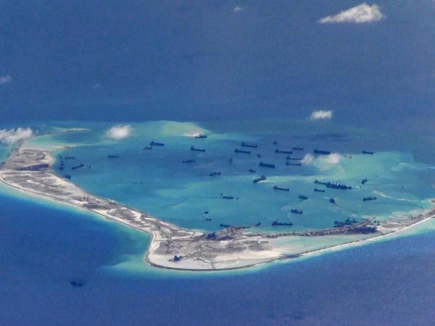 Chinese dredging vessels in the waters around Mischief Reef in the disputed Spratly Islands in the South China Sea